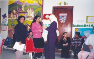 Giving a Talk for Parents, Therapists of Children with Special needs from Bahrain and Saudi Arabia. Bahrain 2002